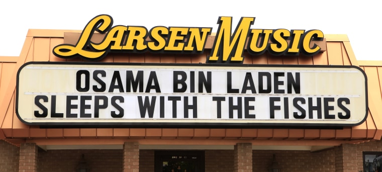 A sign at Larsen Music in Oklahoma City recognizes Osama bin Laden's death and his burial at sea. Osama bin Laden, the face of global terrorism and mastermind of the 9/11 attacks, was tracked down and shot to death Monday in Pakistan by an elite team...