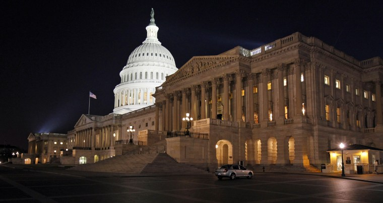 The U.S. Capitol is illuminated at night as Congress continues to work to avert a government shutdown on Capitol Hill.