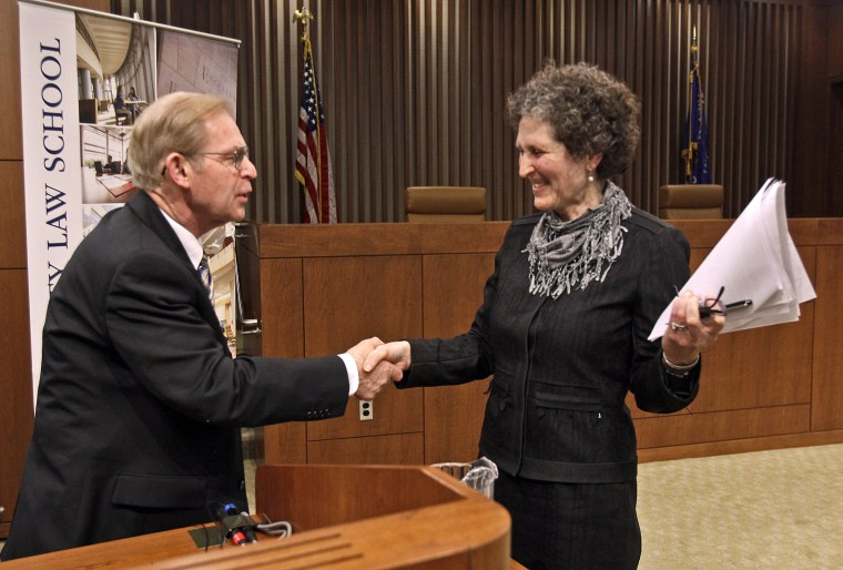 Justice David Prosser shakes hands with Assistant Attorney General JoAnne Kloppenburg after their debate for the Wisconsin Supreme Court at the Marquette University Law School in Milwaukee.