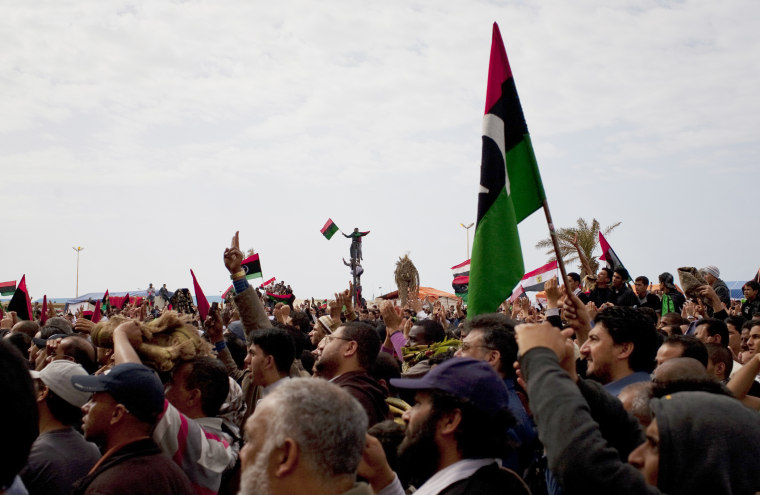 Libyans celebrate in the main square. The U.N. Security Council voted Thursday to impose a no-fly zone over Libya to protect civilians from attacks by Moammar Gadhafi's forces, hours after the Libyan leader vowed to crush the rebellion.