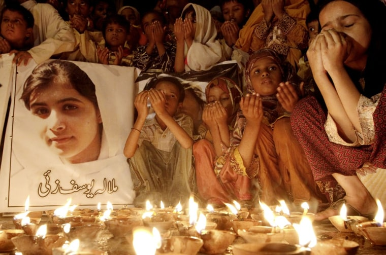 Pakistani children pray for the recovery of 14-year-old schoolgirl Malala Yousufzai during a candlelight vigil in Karachi, Pakistan, Friday.