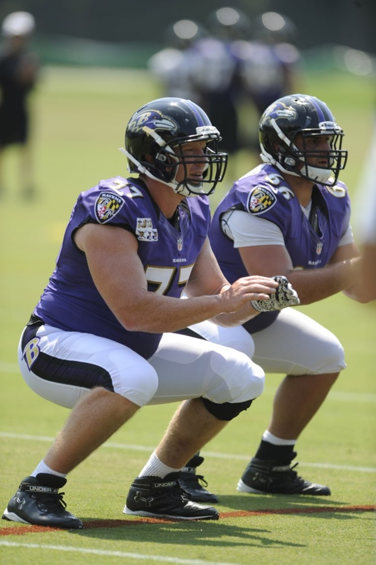 Baltimore Ravens center Matt Birk (L) during drills at a July NFL football training camp. Birk recently spoke out against marriage equality.