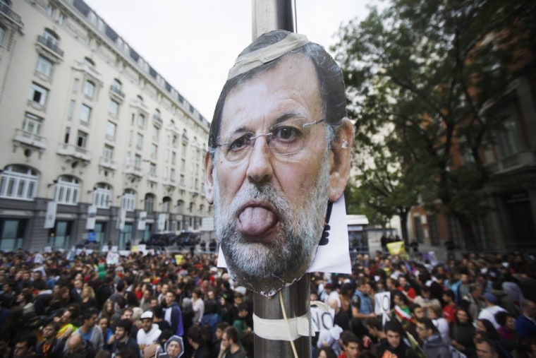 A picture of Spanish Prime Minister Mariano Rajoy is seen during the demonstration in Madrid.