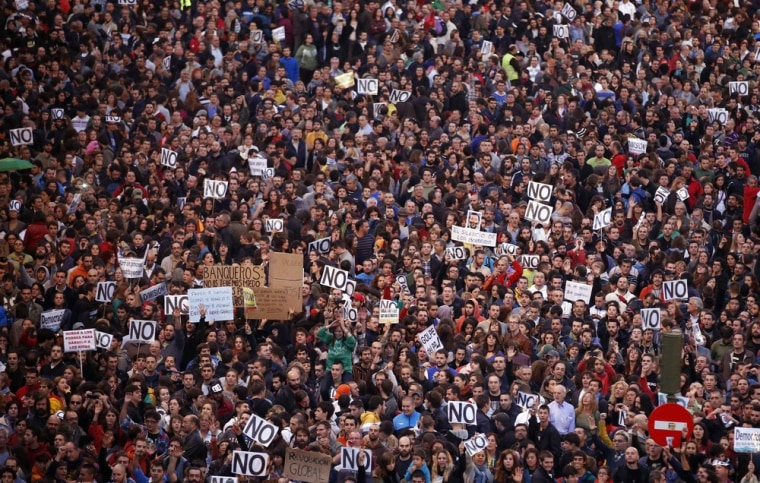 Protestors shout slogans as they fill up Neptuno Square during a demonstration against government austerity measures in Madrid.