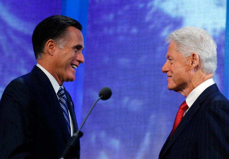 Former President Bill Clinton, right, introduces Republican presidential candidate and former Massachusetts Gov. Mitt Romney at the Clinton Global Initiative in New York on September 25.