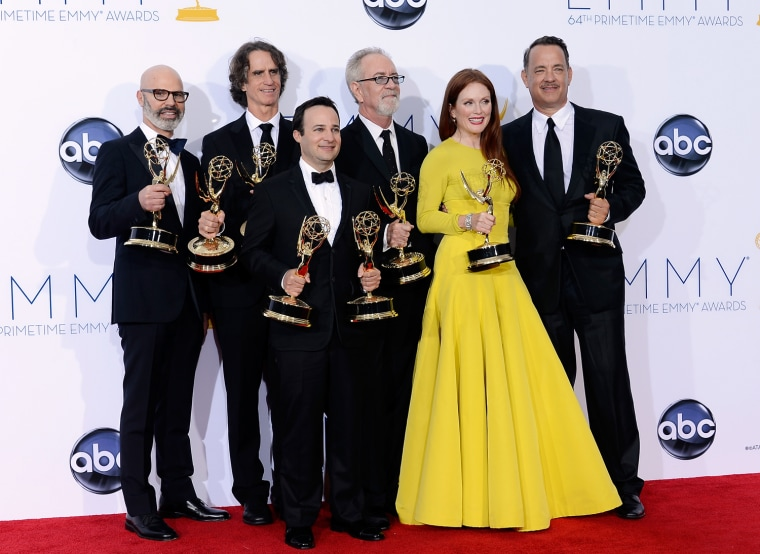 """Producer Steven Shareshian, director Jay Roach, writer Danny Strong, producer Gary Goetzman, actress Julianne Moore, and producer Tom Hanks, winners Outstanding Miniseries or TV Movie for \""""Game Change,\"""" pose in the press room during the 64th Annual..."""
