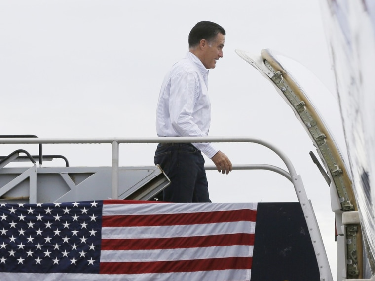 Republican presidential candidate and former Massachusetts Gov. Mitt Romney boards his campaign charter plane in West Palm Beach, Fla., Friday, Sept. 21, 2012.
