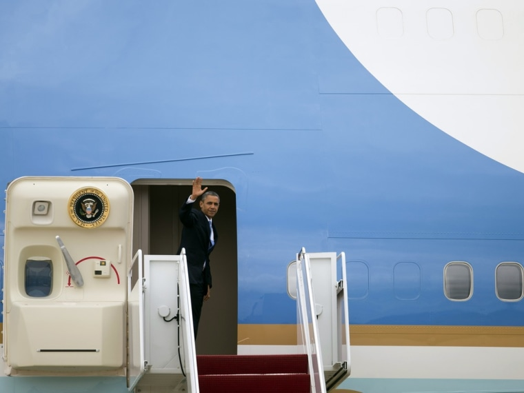 President Barack Obama waves as he boards Air Force One on Tuesday, Sept. 18, 2012 in Andrews Air Force Base, Md.