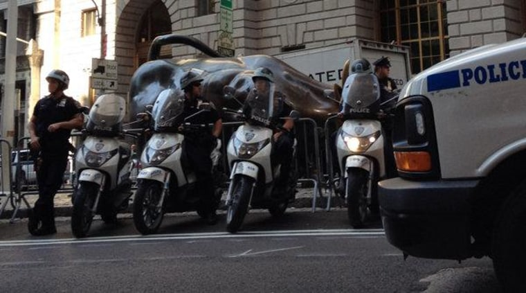 Police officers block the Charging Bull sculpture at Bowling Green Park near Wall Street in New York City on September 17, 2012.