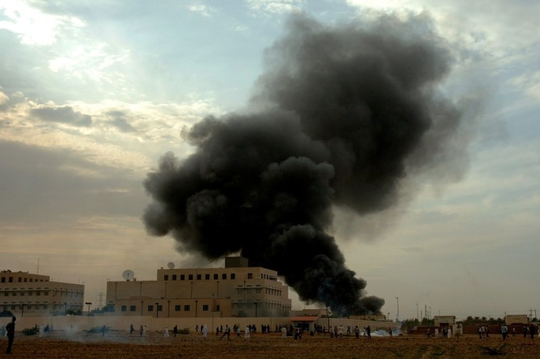 Smoke billows from the US embassy in the Sudanese capital Khartoum on Friday during a protest against an amateur film mocking Islam.