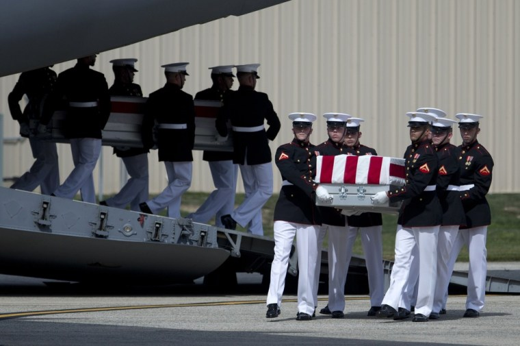 Carry teams move flag draped transfer cases of the remains of the four Americans killed this week in Benghazi, Libya, from a transport plane. Sept. 14, at Andrews Air Force Base.