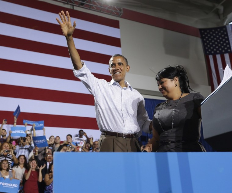 President Barack Obama, left, on stage after being introduced by Viviana Margarita Janer, right, at a campaign event Saturday  at the Kissimmee, Fla., Civic Center.