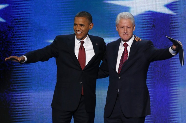 U.S. President Barack Obama joins former President Bill Clinton onstage after Clinton nominated Obama for re-election during the second session of the Democratic National Convention September 5.