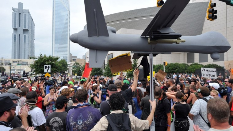 Protesters carry a replica of military drone plane during a demonstration in Charlotte, North Carolina, September 4, 2012 ahead of the opening of the Democratic National Convention.