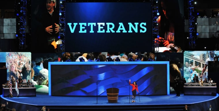 Former Assistant Secretary, U.S. Department of Veterans Affairs Tammy Duckworth waves to the audience at the Time Warner Cable Arena in Charlotte, North Carolina, on September 4, 2012 on the first day of the Democratic National Convention.