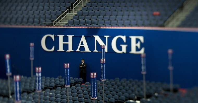 """A member of the US Secret Service stands in front of a \""""Change\"""" sign at the site of the Republican National Convention on August 26, 2012 in Tampa, Florida."""