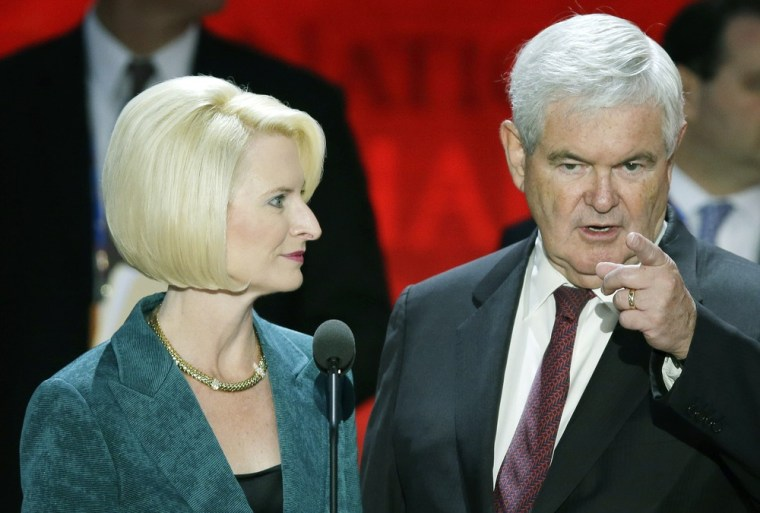 Newt Gingrich and his wife Callista look over the podium during a sound check at the Republican National Convention on Tuesday, Aug. 28, 2012.