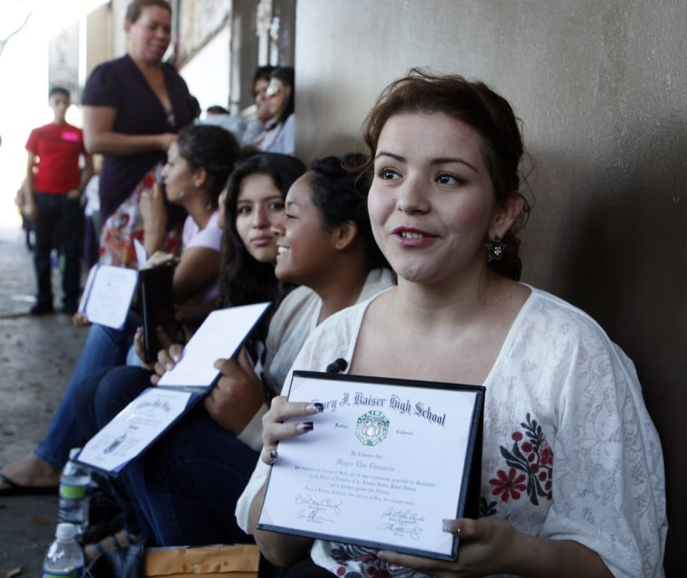 Illegal immigrant Mayra Chavarria holds her high school diploma while waiting outside the Coalition for Humane Immigrant Rights in Los Angeles offices Wednesday, Aug. 15,  2012.  Hundreds of thousands of young illegal immigrants scrambled to get papers...