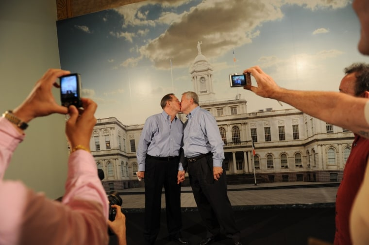 Same-sex couple Ray Durand (L) and his partner Dale Shields kiss while having their picture taken after their wedding ceremony at the Manhattan City Clerk's office on the first day New York State's Marriage Equality Act goes into effect July 24, 2011...