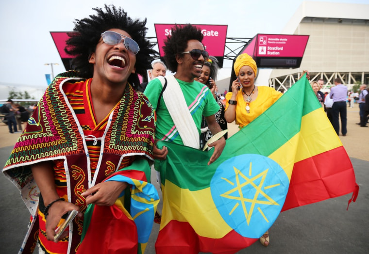 Fans of Ethiopia enjoy the atmosphere outside the Olympic stadium before the opening ceremony on July 27, in London.