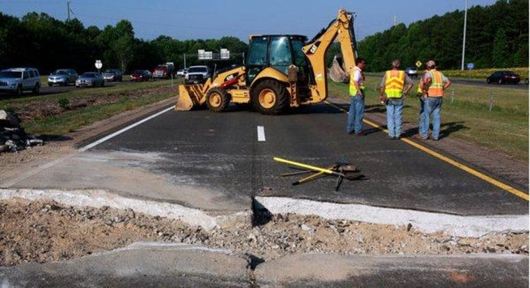 Heat causes a highway to buckle in North Carolina.