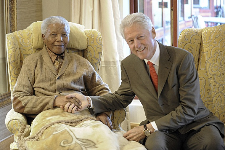 Former U.S. President Bill Clinton visits former South African President Nelson Mandela at his home in Qunu in South Africa's Eastern Cape Province on July 17, 2012.