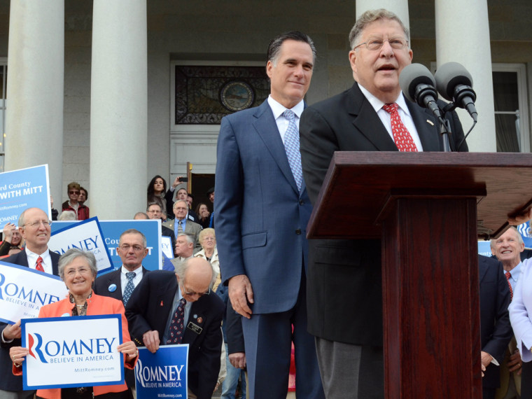Mitt Romney listens as former New Hampshire Governor John Sununu endorses him for president outside the Statehouse October 24, 2011 in Concord, New Hampshire.