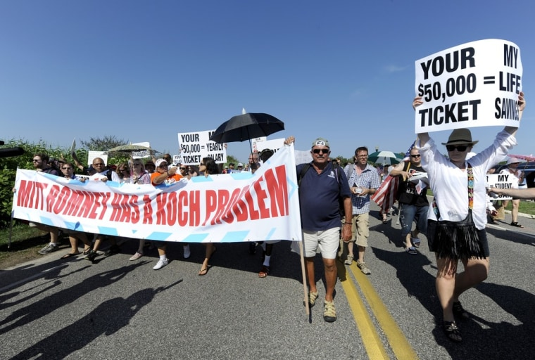 Protesters from MoveOn.org, the Occupy Movement, and the Long Island Progressive march down Meadow Lane at a fundraiser for Republican presidential candidate Mitt Romney on Sunday, July 8, in Southampton, N.Y. Romney's fundraiser at the Southampton...