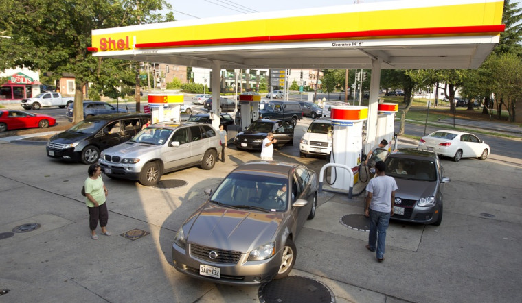 Drivers crowd a gas station in the Tenleytown section of Washington, D.C., June 30, during a massive power outtage resulting from a powerful storm late Friday.