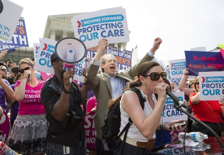 Supporters of the Affordable Healthcare Act celebrate in front of the Supreme Court after the court upheld the legality of the law in Washington June 28, 2012.