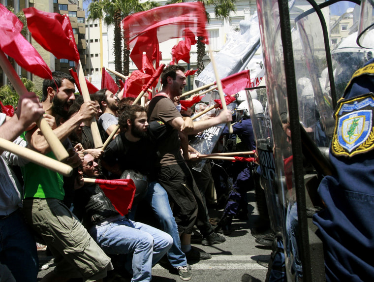 Protesters clash with policemen during riots at a May Day rally in Athens.