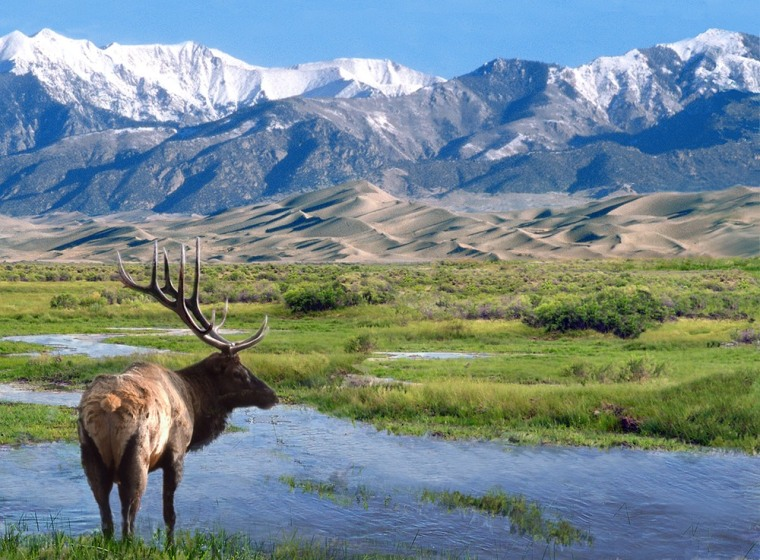 The Sangre de Cristo Mountains, seen here from the Great Sand Dunes National Park, are the backbone of a proposed conservation area announced Friday with a billionaire's pledge to protect 90,000 acres from development.
