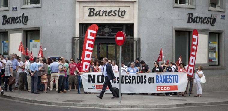 Spain's economic crisis includes protests like this one in Madrid on Friday, where people rallied against layoffs at Banesto bank.
