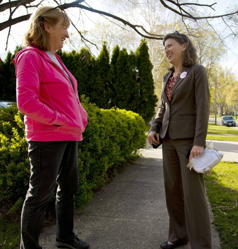Lori Compas (right), talking to a voter during her campaign for Wisconsin state senate.