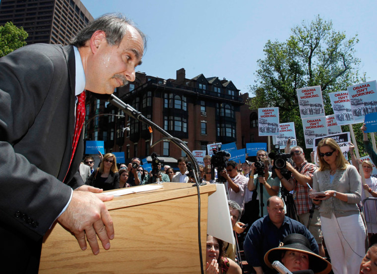 U.S. President Barack Obama's campaign's senior strategist David Axelrod leans over the podium to listen to a reporter's question during a news conference held outside the Massachusetts State House in Boston, May 31, 2012.