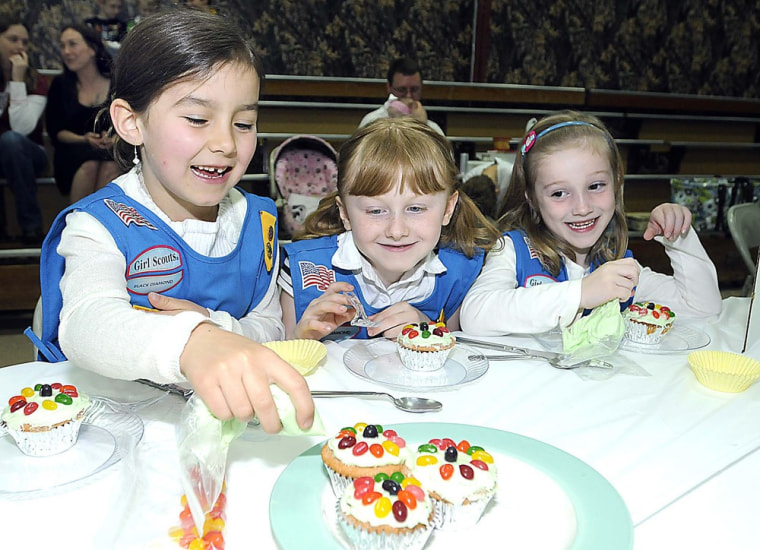Magnolia Scott, left, Alivia Whitlock and Hannah Beeson, troop 2578, Divide Elementary School students in Lookout W.V., participate in the Girl Scout Regional Cupcake Challenge held at Crosspoint Church in Beckley, W. Va.