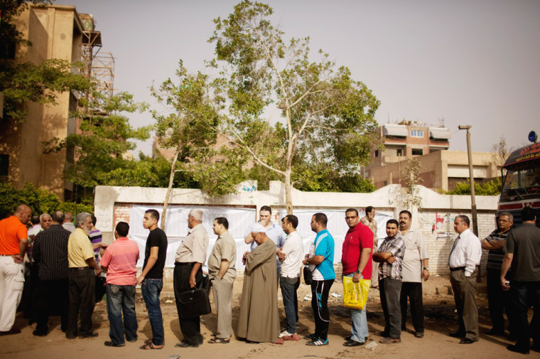 Egyptian voters line up to cast ballots in Basateen, a southern suburb of Cairo, Egypt on Wednesday, May 23, 2012. On Wednesday morning, Egypt commenced two days of presidential voting after 16 months of interim rule by the Supreme Council of Armed...