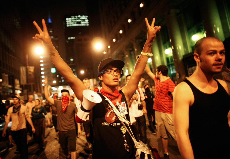 Demonstrators flash the peace sign during an anti-NATO protest march in Chicago May 20, 2012. Four police officers were injured and 45 demonstrators arrested after baton-wielding police clashed with anti-war protesters marching on the NATO summit in...