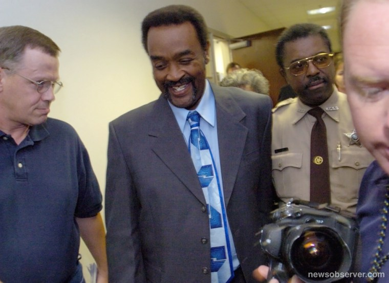 Sylvester Smith, center, smiles after he was granted a new trial after two witnesses recanted their testimony in a Brunswick County courtroom in Bolivia, N.C., Nov. 5, 2004. He had wrongfully served 20 years on a sexual assault charge.