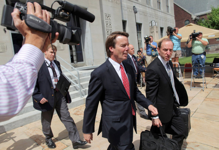 John Edwards exits a federal courthouse next to one of his defense lawyers, Abbe Lowell (R) in Greensboro, North Carolina May 10, 2012. Edwards, 58, is accused of secretly soliciting more than $900,000 in illegal campaign funds from two wealthy donors...