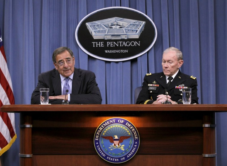 Defense Secretary Leon Panetta, accompanied by Joint Chiefs Chairman Gen. Martin E. Dempsey, outlines the main areas of proposed spending cuts during a news conference at the Pentagon, Thursday, Jan., 26, 2012. (AP Photo/Pablo Martinez Monsivais)