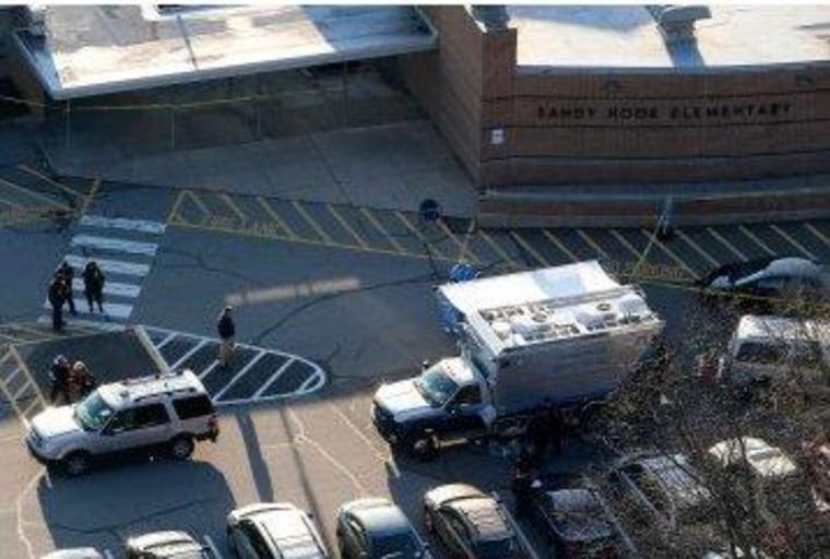 The scene outside of Sandy Hook Elementary School in Newtown, Conn., on Friday.
