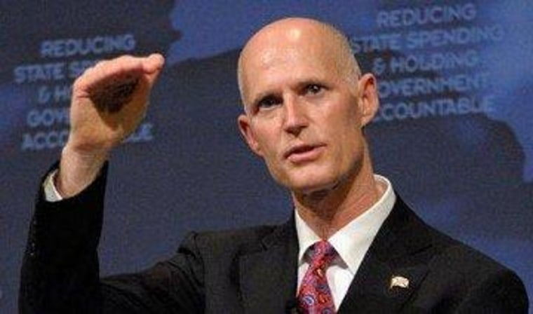 Florida's Scott refuses to implement federal law