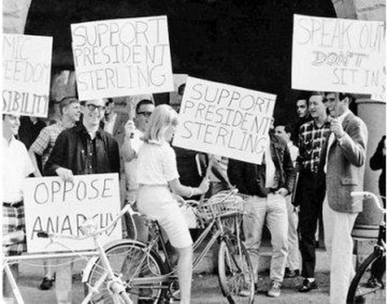 Romney in 1965, seen on the far right, protesting in support of the Vietnam War.