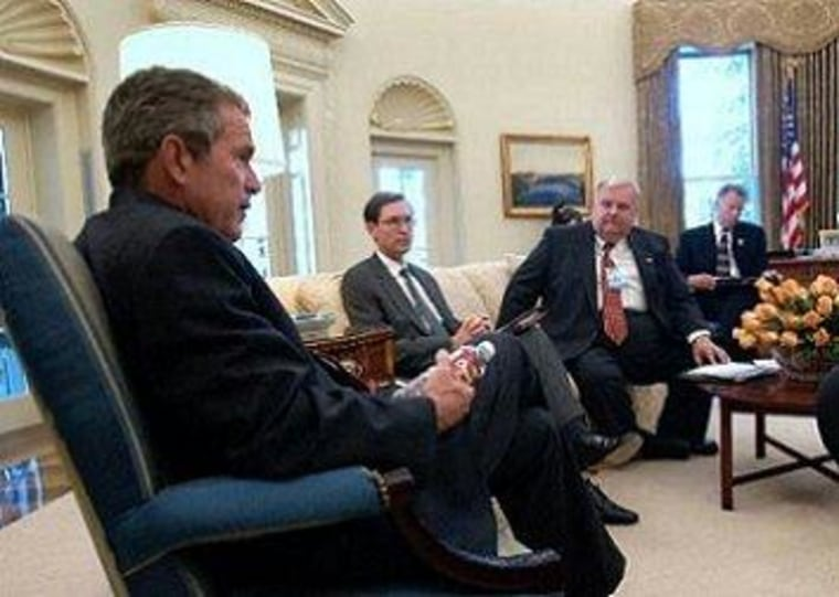 Glenn Hubbard, sitting to the right of George W. Bush in the Oval Office.
