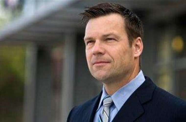 Kris Kobach, Romney's far-right immigration adviser.