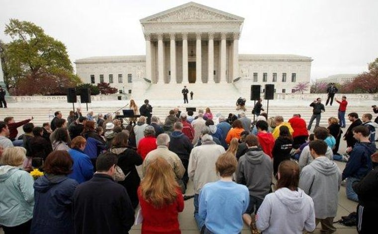 Conservative opponents of 'Obamacare' prayed outside the Supreme Court yesterday.
