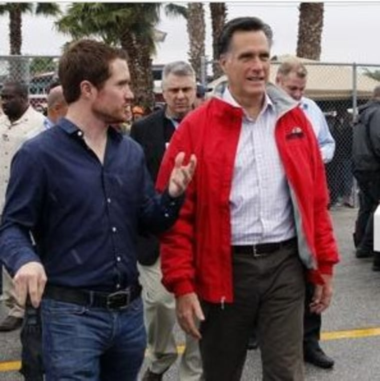 Romney at a NASCAR event, doing his best imitation of a normal person.