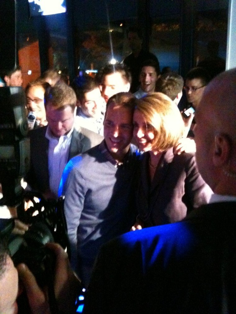 House Minority Leader Nancy Pelosi arrives at the SLDN party