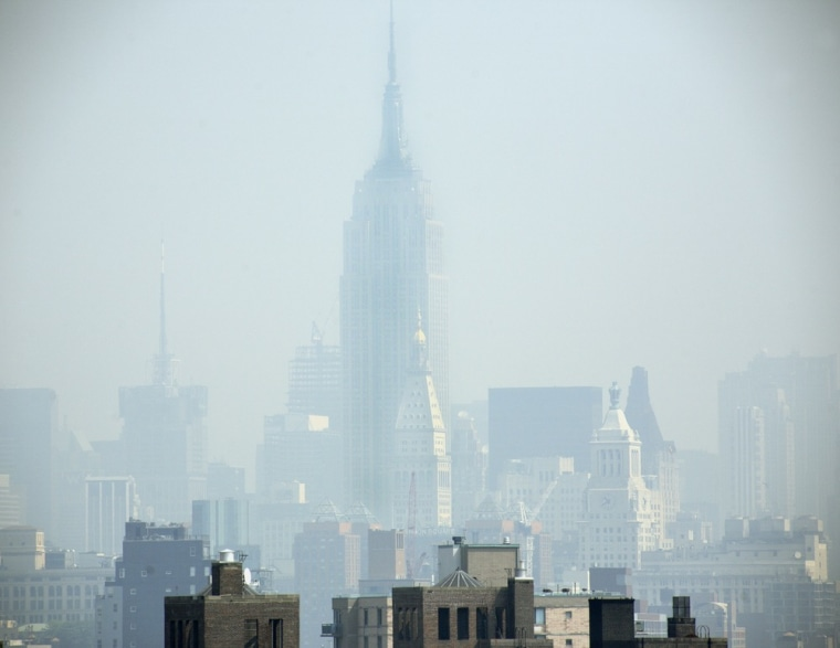 """This July 10 2007 file photo shows smog covering midtown Manhattan in New York.  The EPA on Friday, April 17, 2009, declared that carbon dioxide and five other greenhouse gases sent off by cars and many industrial plants """"endanger public health and..."""